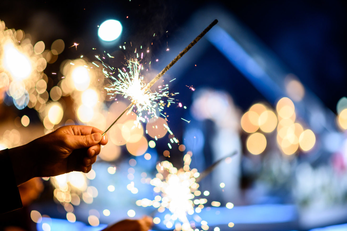Man hand holding a burning sparkler. Bengal fire